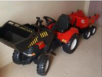 Large red Tractor along with trailer