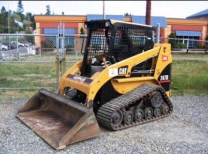 Bobcat excavator rock breaking truck hire artificial turf