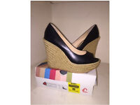 Office black leather wedges brand new