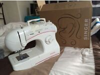 Singer sewing machine boxed as new