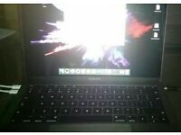 Macbook Pro with free HP bluetooth mouse worth £50
