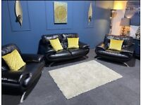 Beautiful black leather suite. 2 seater sofa and 2 chairs