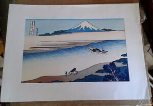 Two Japanese woodblock prints and one painted leaf