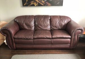 Comfy leather couch in good condition, pet and smoke free