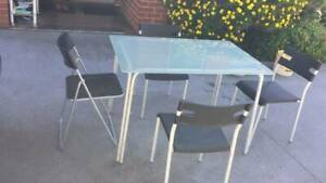 ikea glass top dining table with 4 chairs   size is 120 cm w x 60 cm d