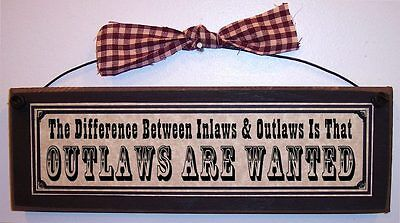Difference Between Inlaws   Outlaws  Outlaws Are Wanted  Funny Family Sign