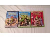 SHREK, SHREK 2 AND SHREK THE THIRD. THREE GOOD CONDITION DVDs.