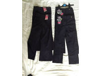 Girls navy blue school trousers age 6 new with tags x4 pairs.