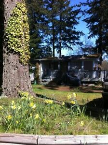 Mobile home on almost half an acre