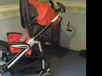 Buggy with transparent rain protector and including carry-cot, red, grey and black.