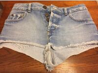 Woman's Topshop high waisted denim shorts, size 8