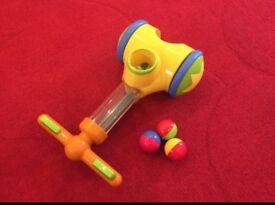 Child's Tomy pic n pop walker toy