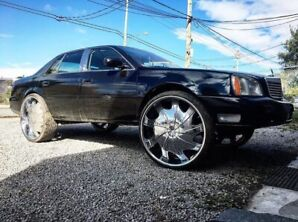 "2004 Cadillac de ville on 30"" rims"