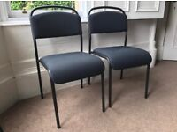 2 black padded seat and back Ikea chairs - like new