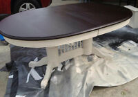 White oval shabby dining table with black stained top