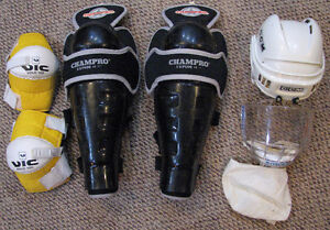 Hockey shin and elbow pads with helmet