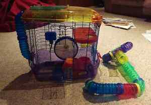 Hamster cage, wheel, food and bedding