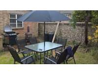 Garden table with 6 chairs, parasol and weighted stand
