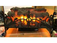 Old fashioned wrought iron log effect fire heater