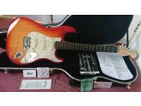Fender American Deluxe Stratocaster And Fender Hardshell Case.
