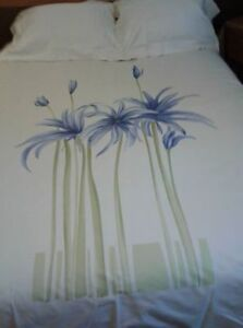 TWO SETS OF IVORY PRINTED REVERSIBLE DUVET COVERS
