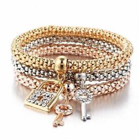 Ladies costume jewellery lock and key design bracelets