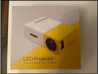 Mini LED projector HDMI input projects up to 80 inch