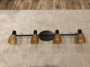 Light fixture. Excellent condition. 32 inches wide. $10