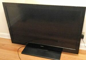 Sanyo 55in. Tv stand  Samsung Home Theater Bar