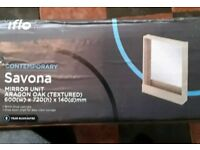 IFLO SAVONA ARAGON OAK MIRROR UNIT WITH DROP DOWN SHELF . NEW BOXED.