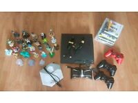 Sony Ps3, 3 pads, 7 games, usb charger and 23 disney infinity