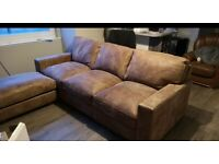 Less than 2 yrs old, Italian tan leather, 4 seater sofa with matching footstool in great condition