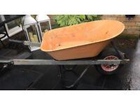 Wheelbarrow, well used, in great working order.