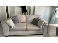 4 seater and 3 seater sofa with matching storage puffay