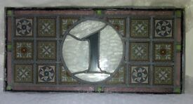Leaded stained glass fanlight (over door) window. Number 1