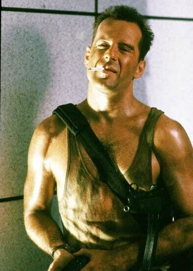 Bruce Willis as John McClane cigarette in mouth looks tough 5x7 inch photo