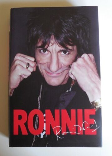 RONNIE WOOD SIGNED LIMITED EDITION BOOK AND CARICATURE ROLLING STONES....$695.00