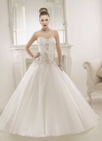Wedding dress by Ronald Joyce. size 14. Less than 3 years old and has been dry cleaned