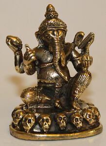 White metal gold silver statue sitting ganesh w skull home for Home decor nepal