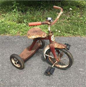Vintage rusty tricycle for fixing up. Garden decor, works still