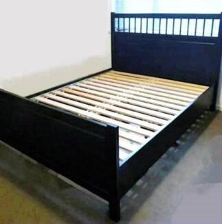 dark brown Ikea timber queen bed frame with mattress