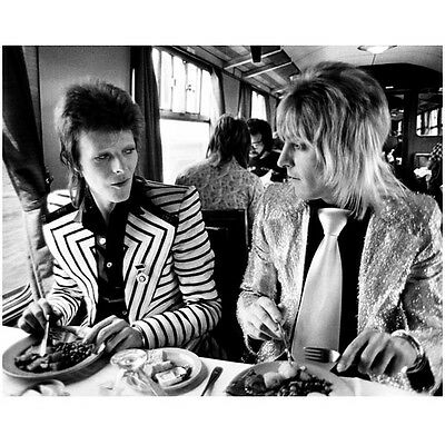 David Bowie with Fellow Rock Star on Train 8 x 10 Inch Photo ()