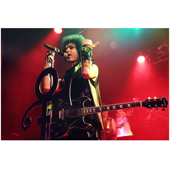 Prince Performing on Stage Holding Arms Up by Mic 11 x 14 inch photo