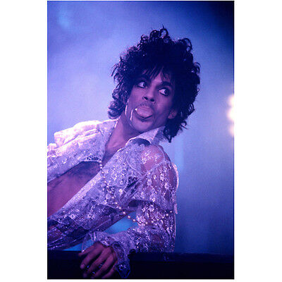 Prince on Stage Sticking Tongue Out Wearing Open Shirt 8 x 10 inch photo