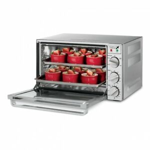 Commercial Quarter-Size Convection Oven, new in box. Four