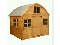 A brand new child's large wooden play house .