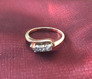 14kt gold ring (size 6) with 3 small diamonds