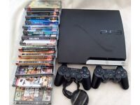 PS 3 - console , 2 controllers and 14 games