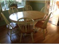Extending dining table and 4 matching chairs - great condition