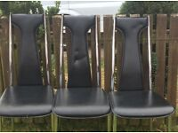 Black and chrome leather chairs